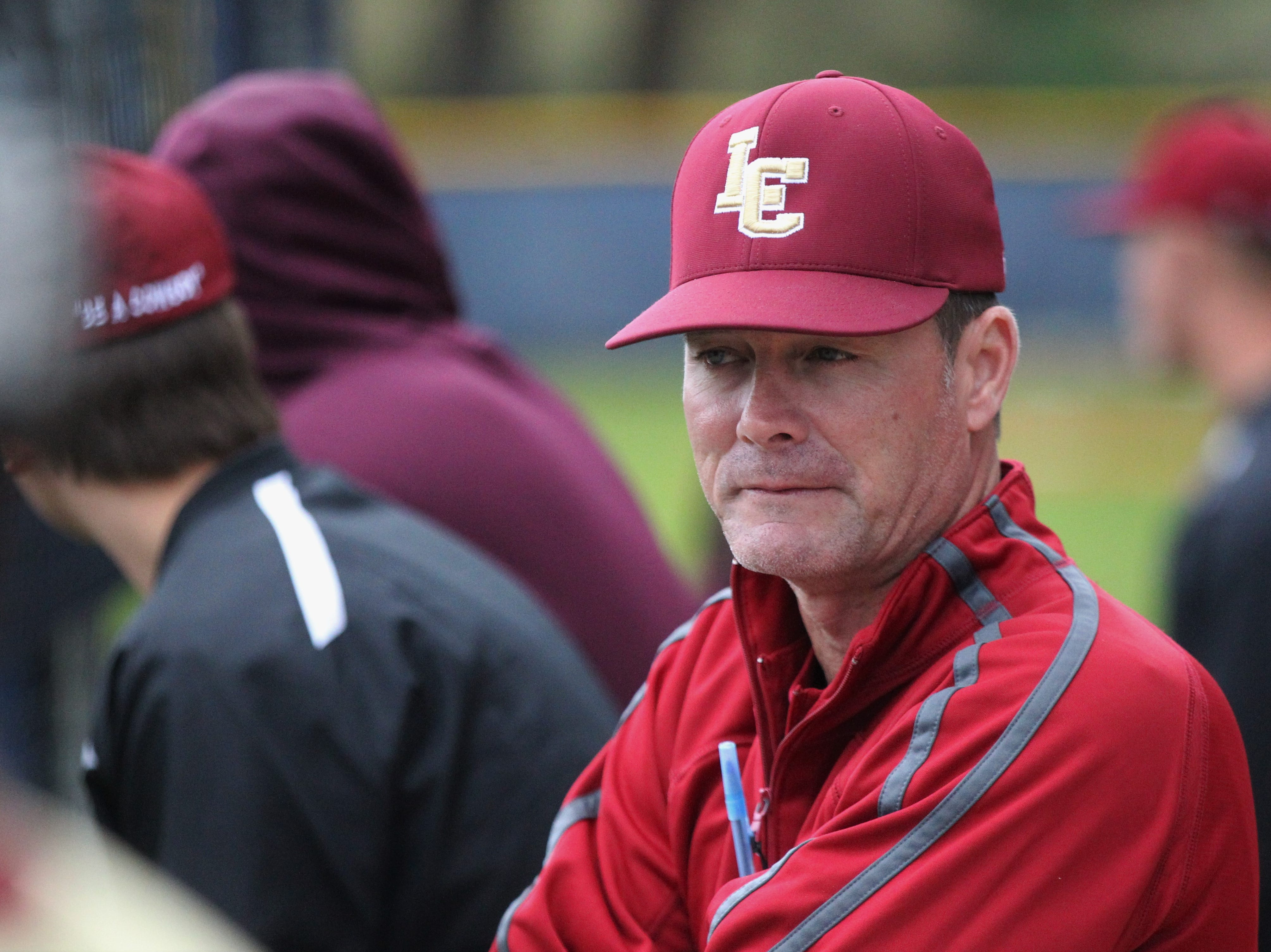 Former Liberty County baseball coach and current assistant principal Tim Davis watches as Liberty County's baseball team went on the road to beat Maclay 8-2 on Saturday, March 16, 2019. The Bulldogs played their first game following their head coach Corey Crum's tragic death six days ago.