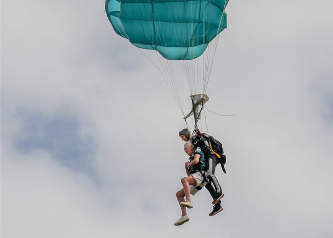 """Celebrating his 90th birthday, Jack Grimner (left), a Port St. Lucie and St. Petersburg snowbird from Philadelphia, comes in for a landing on a tandem skydive with instructor Ian Brown on Sunday, March 17, 2019, at Skydive Sebastian in Sebastian. """"It was fantastic, the views spinning around, it was great,"""" Grimner said. When asked was it everything he thought it would be, Grimner replied, """"No, it was worse, I thought it was going to be easier, I'm not going to do it again,"""" to the sound of laughter from his family surrounding him after landing. Several other family members joined Grimner during the tandem skydives."""