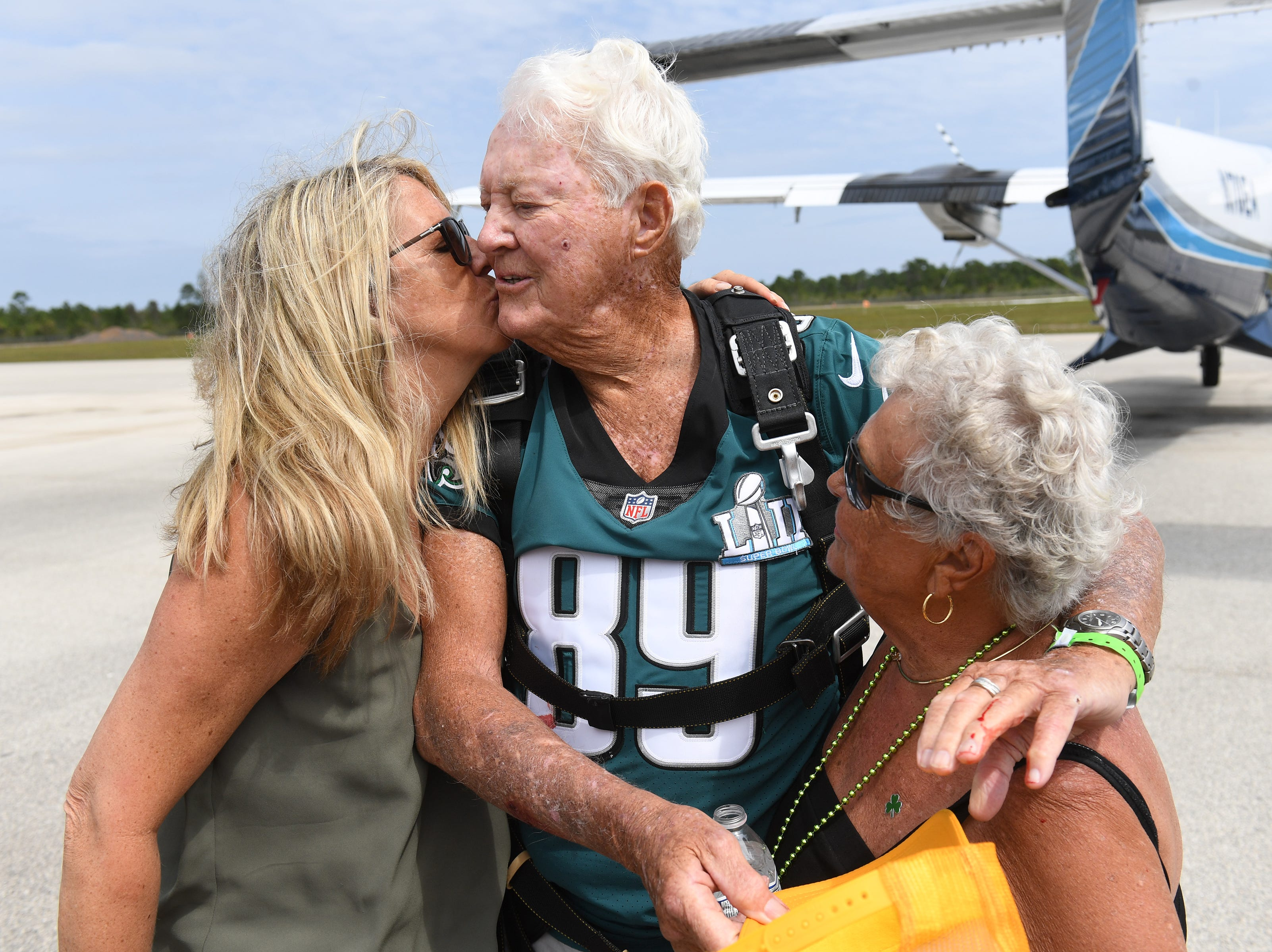 Celebrating his 90th birthday, Jack Grimner, a Port St. Lucie and St. Petersburg snowbird from Philadelphia, wears a number 89 Philadelphia Eagles green jersey while taking a tandem skydive with family members at Skydive Sebastian on Saint Patrick's Day Sunday, March 17, 2019, in Sebastian.