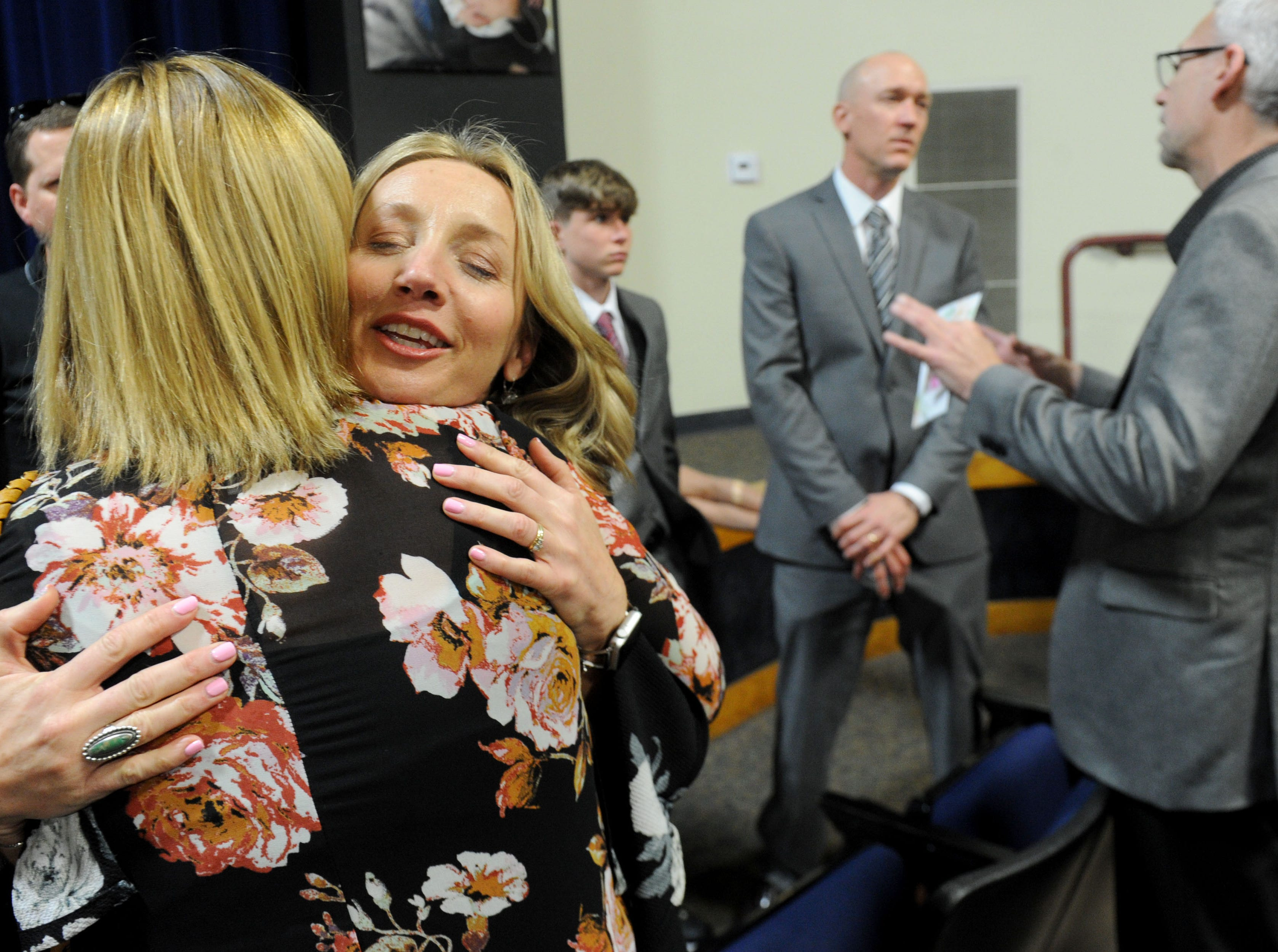 Karen Rogers hugs Renee Lawson at the memorial service for Kimberly Lopez on Saturday in Oxnard. Rogers is the former foster mother for Kimberly Lopez. The Rogers family cared for Kimberly in the first year of her life, after she was removed from her parents' care for the first time.