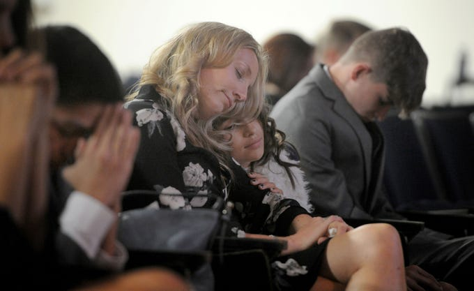 Karen Rogers and her daughter Sofie Rogers comfort each other during a memorial service for Kimberly Lopez on Saturday in Oxnard. Kimberly, of Oxnard, was reported missing in 2016. Police later learned that she had died a year earlier, shortly after her third birthday. Her parents hid her body in Mexico after she died. The Rogers family cared for Kimberly during the first year of her life.
