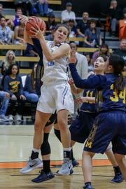 Freshman Emily Herring rips down a rebounding during Moorpark College's CCCAA state semifinal against Merced College on Saturday night at Ventura College. Moorpark won, 73-68.