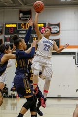 Freshman Breanna Calhoun shoots a runner during Moorpark College's CCCAA state semifinal against Merced College on Saturday night at Ventura College. Moorpark won, 73-68.
