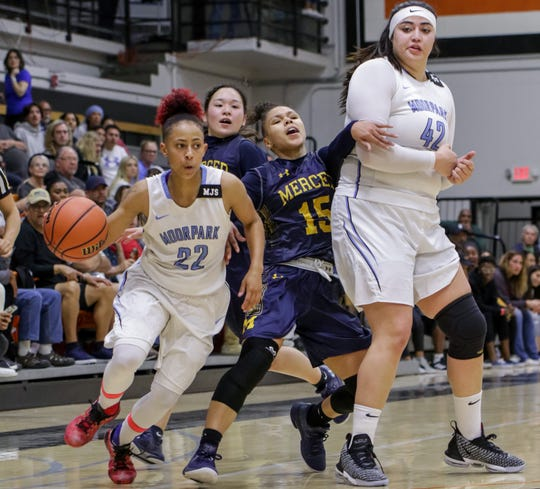 Freshman Breanna Calhoun drives around a pick set by sophomore Barbara Rangel (right) during Moorpark College's CCCAA state semifinal against Merced College on Saturday night at Ventura College. Moorpark won, 73-68.