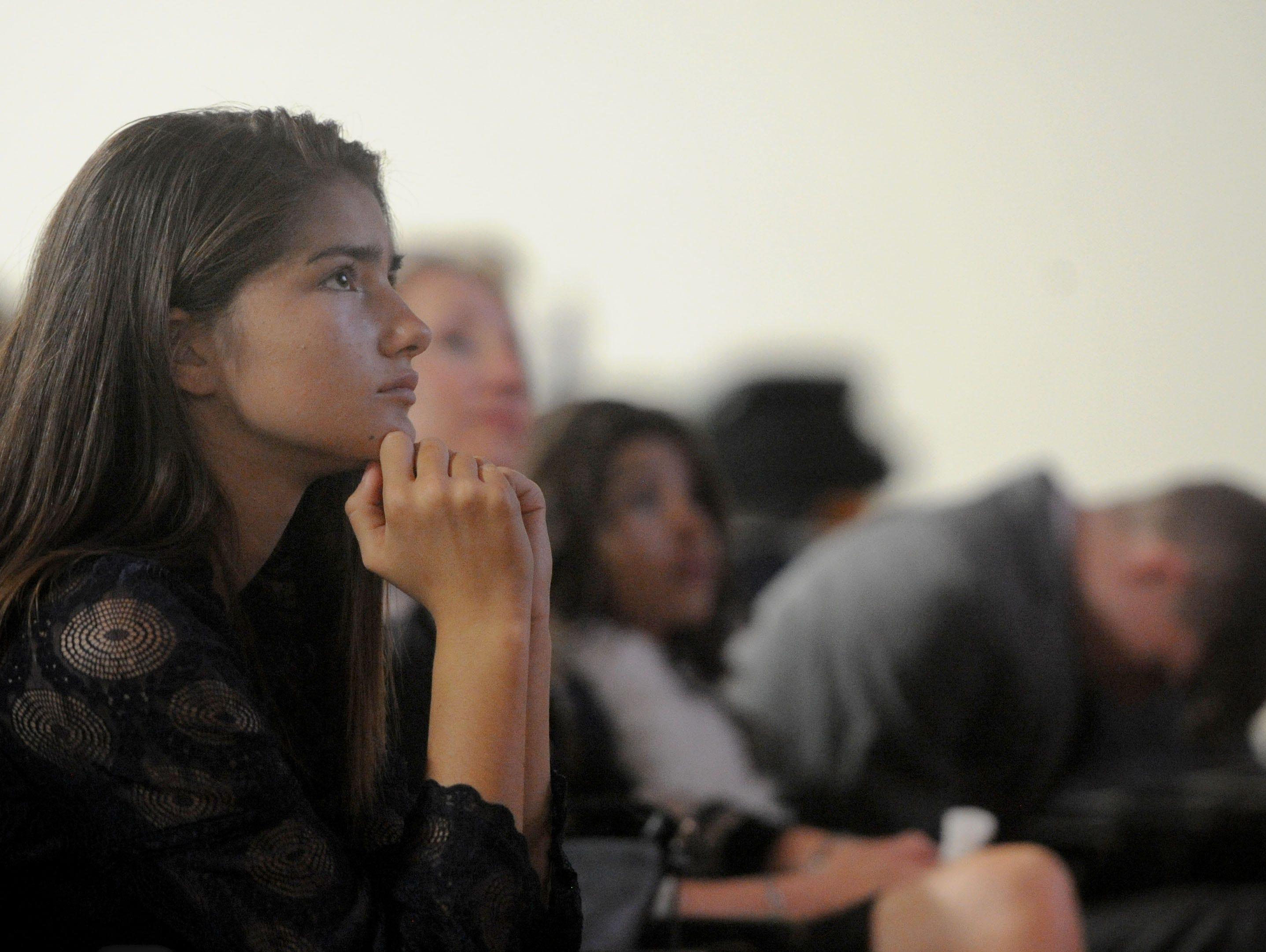 (Left to right) Lilah Rogers, 14,  watches her father speak about Kimberly Lopez at a memorial service for the girl Saturday in Oxnard.