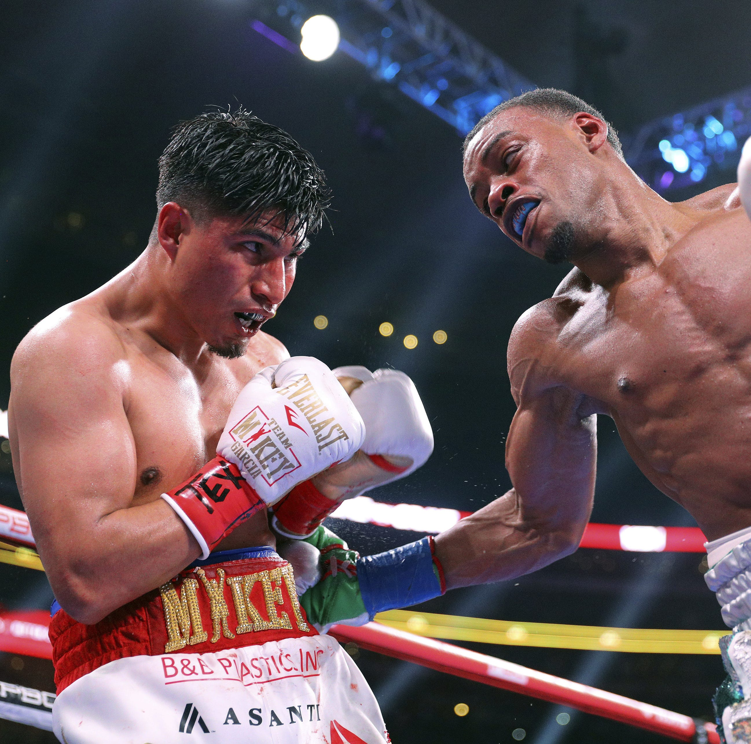 Spence defends IBF title, hands Mikey Garcia his first loss in 40 pro fights