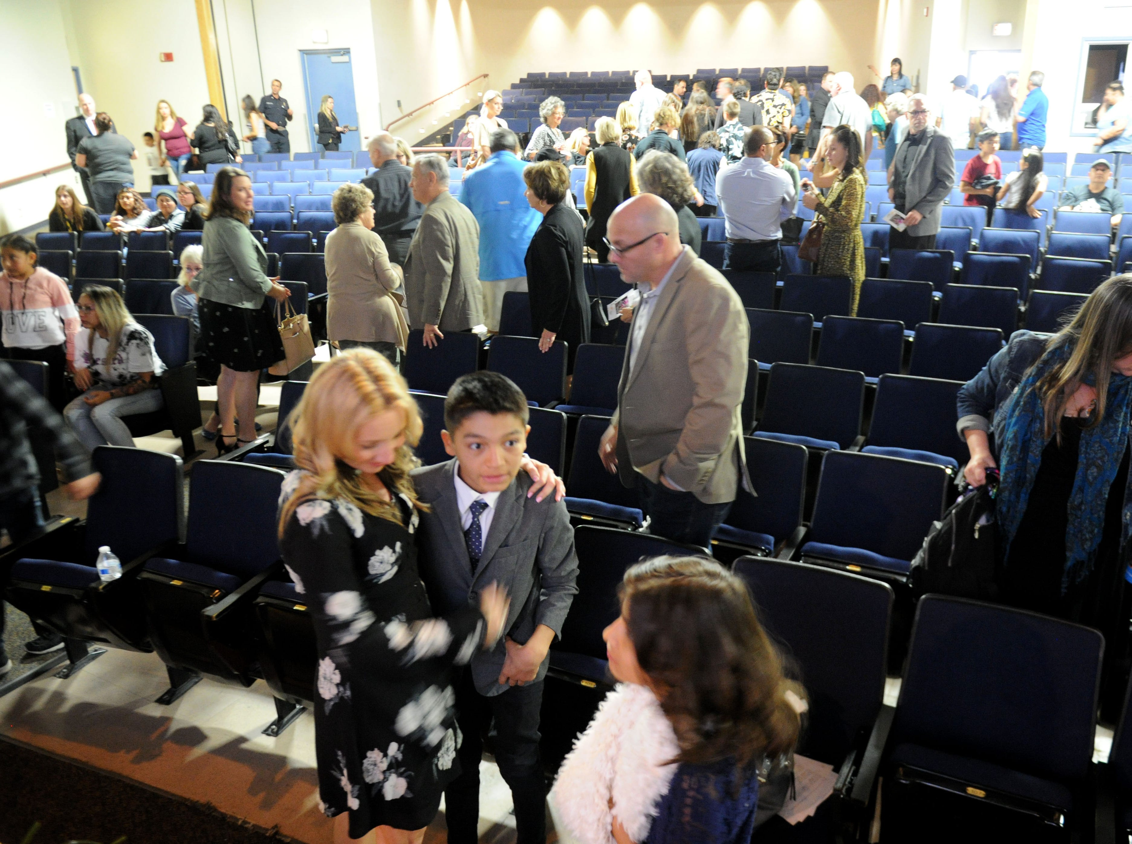 Karen Rogers (front left) hugs her son George Rogers, 11, at the end of the memorial service for Kimberly Lopez, the family's former foster daughter, on Saturday in Oxnard.