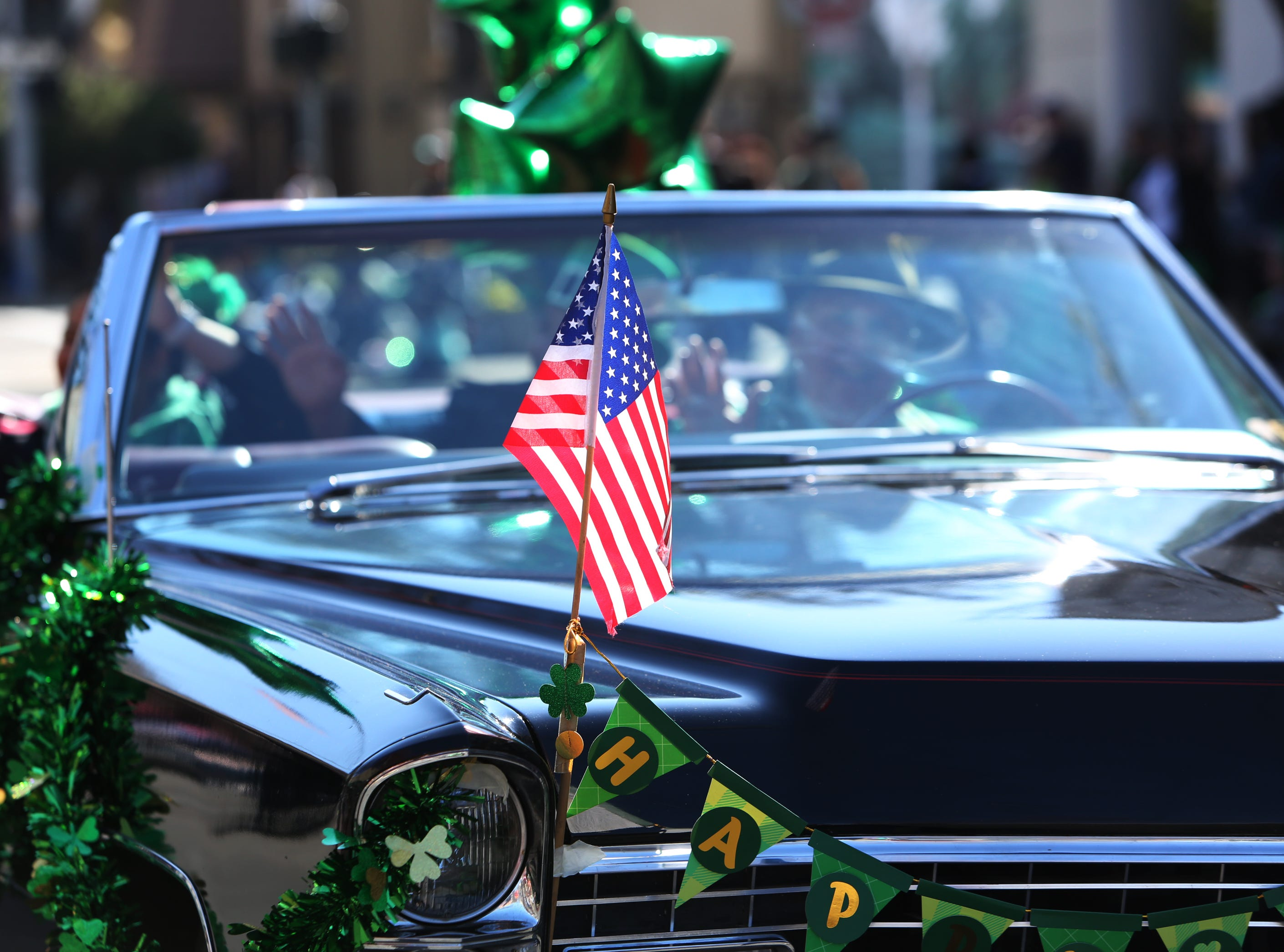 Patriotic entry in this year's St. Patrick's Day parade rolling through Main Street Saturday, March 16, 2019 in Visalia, Calif.