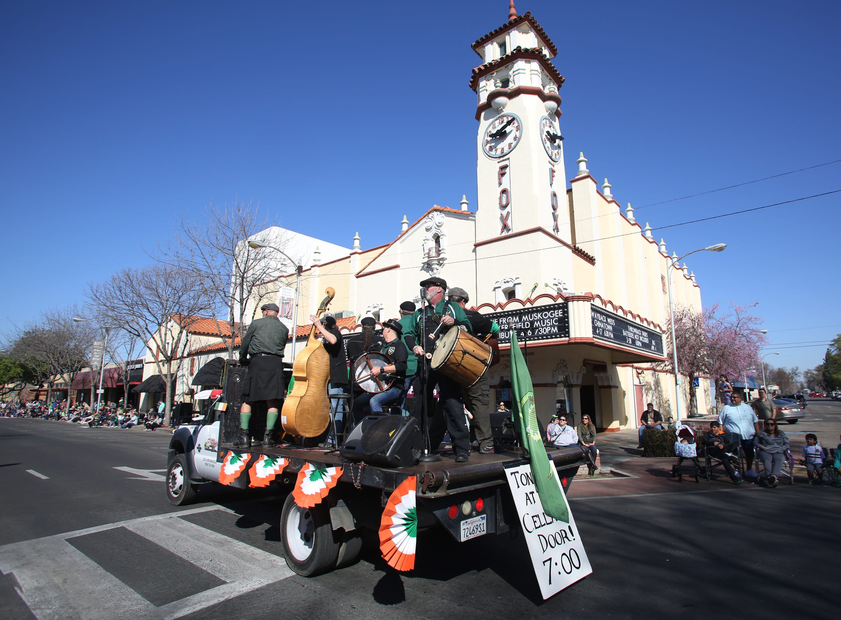 The band Heinrich Patriots performs at this year's St. Patrick's Day parade rolling through Main Street Saturday, March 16, 2019 in Visalia, Calif.