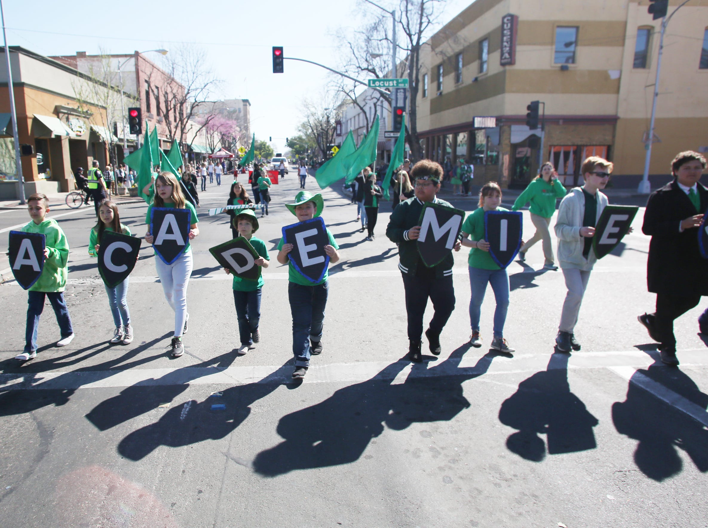 The Academies march on at this year's St. Patrick's Day parade rolling through Main Street Saturday, March 16, 2019 in Visalia, Calif.