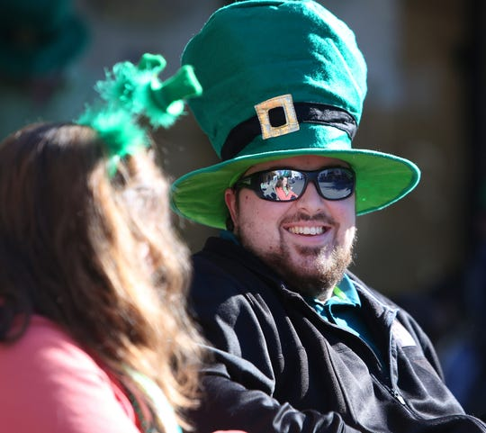 Matthew Fairfield wears a festive hat at this year's St. Patrick's Day parade rolling through Main Street Saturday, March 16, 2019 in Visalia, Calif.