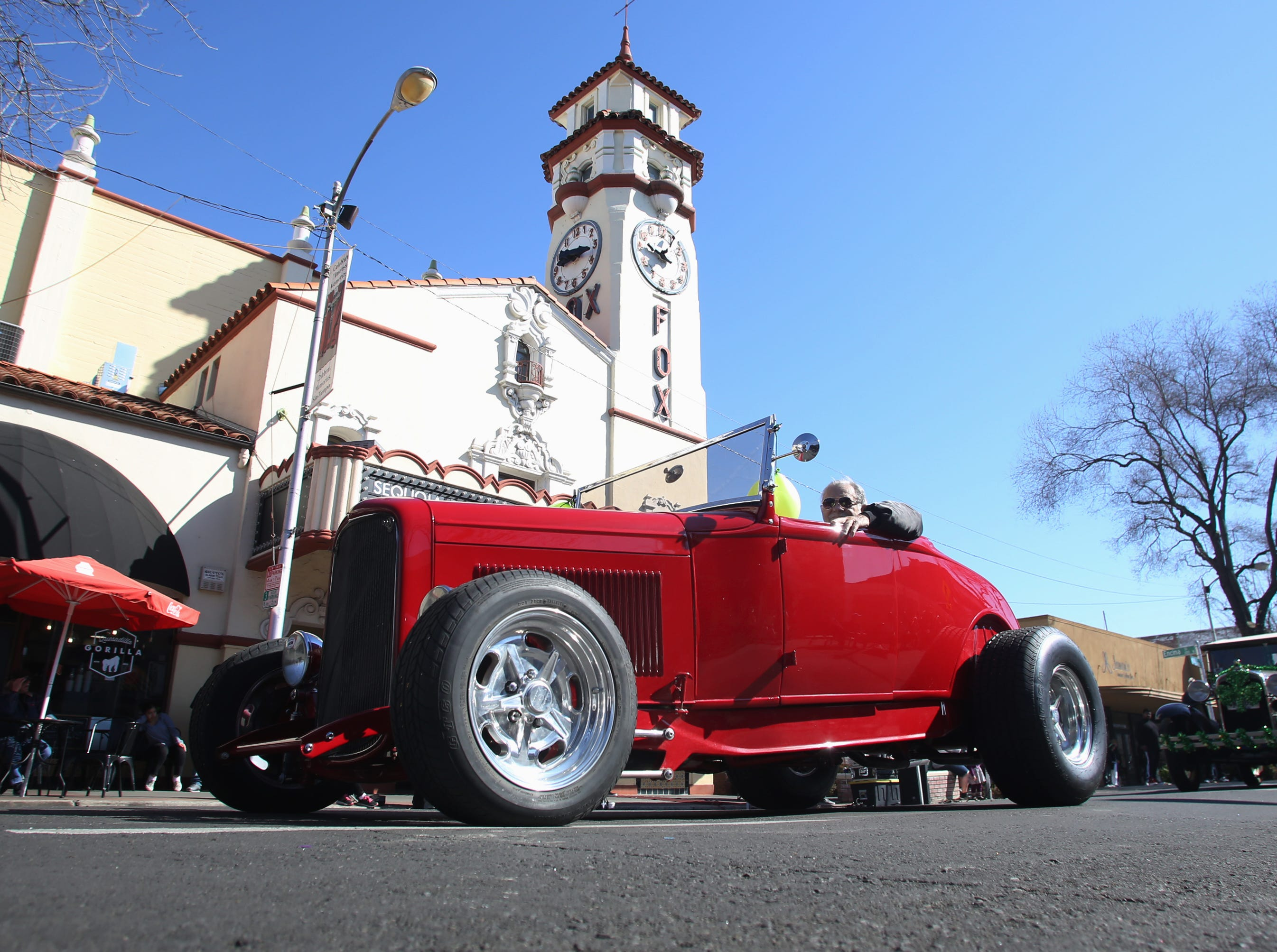 The Horseless Carriage Club of Tulare rolls on by the Fox at this year's St. Patrick's Day parade rolling through Main Street Saturday, March 16, 2019 in Visalia, Calif.