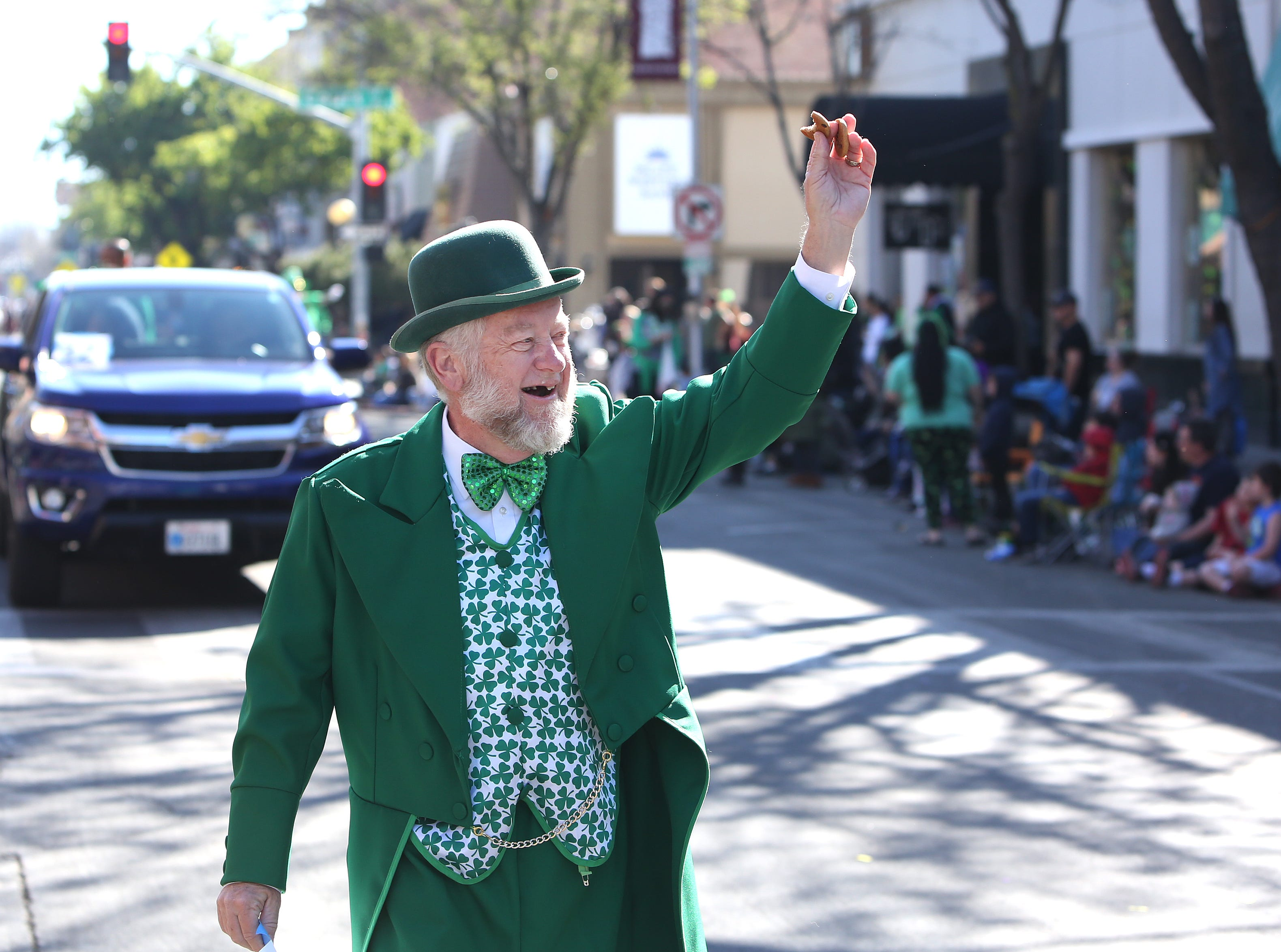 Bill Bates shows his green attire off at this year's St. Patrick's Day parade rolling through Main Street Saturday, March 16, 2019 in Visalia, Calif.