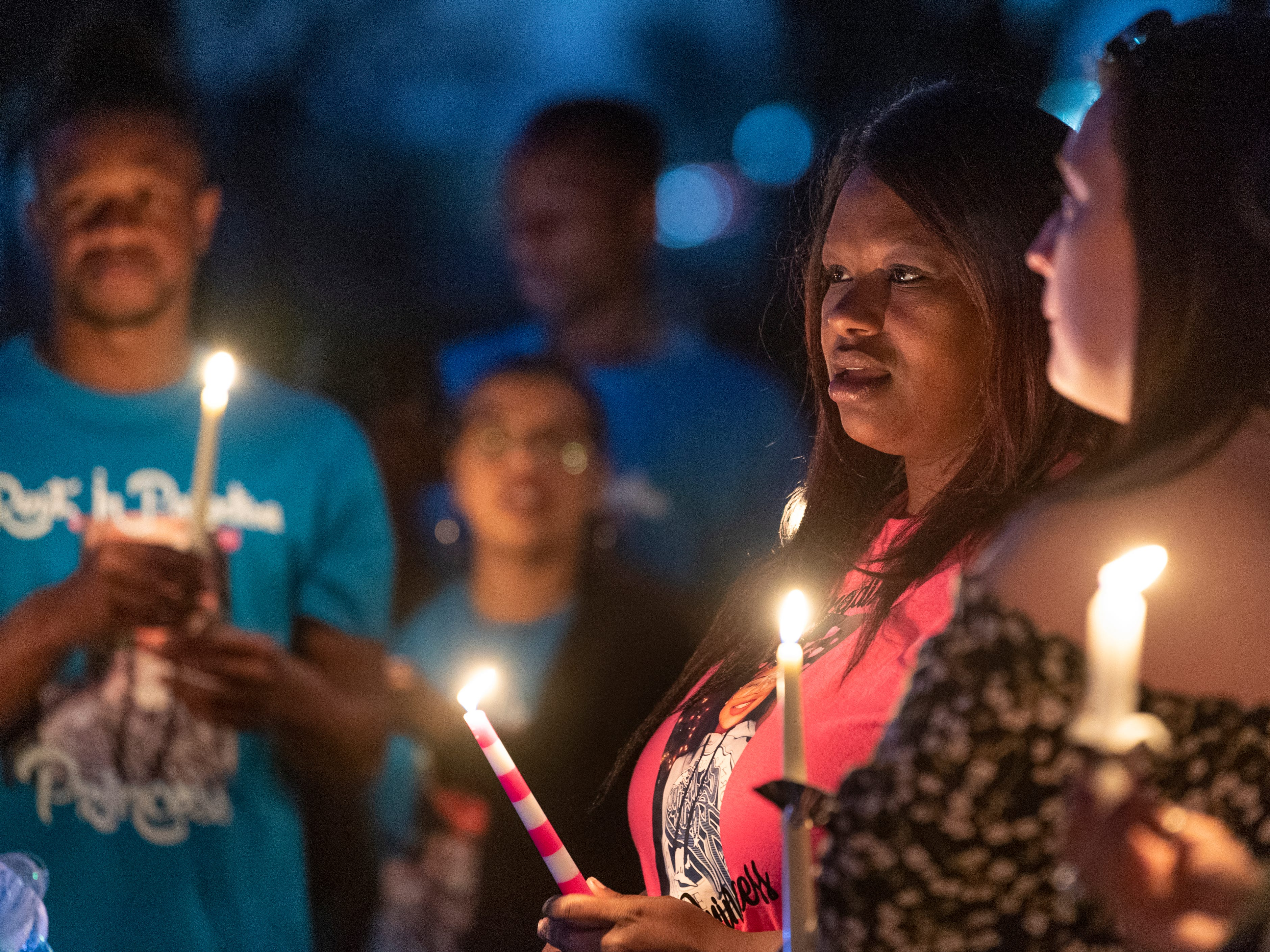 Monisha Alexander, center, is surrounded by family and friends of her daughter Dynasty Alexander at Elk Bayou Regional Park on Saturday, March 16, 2019. Dynasty was remembered with birthday cake, a balloon launch and a candle light vigil. Alexander's body was found in an orchard outside of the city on March 3. She had been strangled and shot.