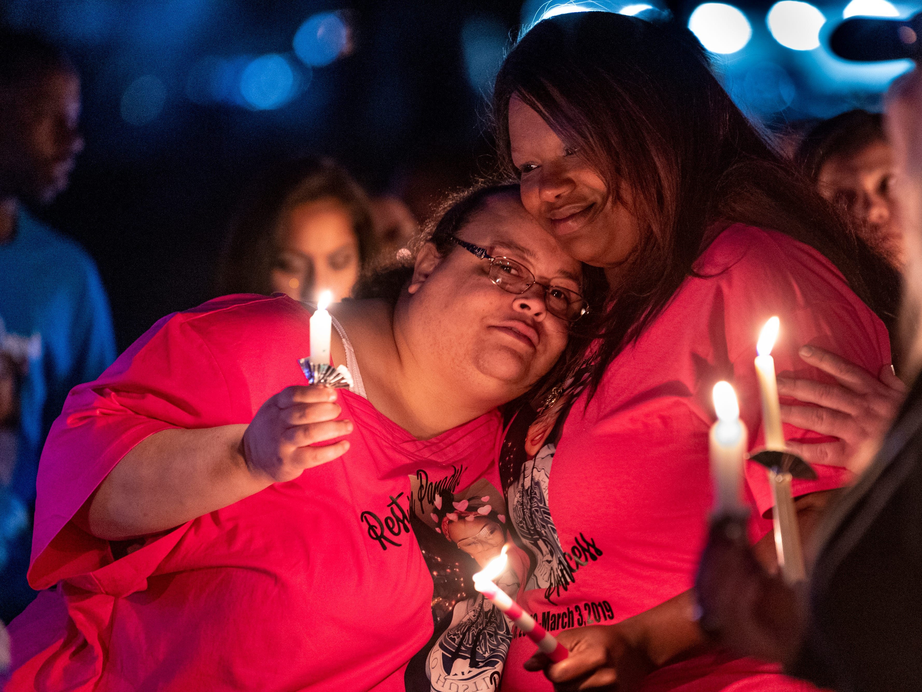 Antoinette Fuller, left, comforts Monisha Alexander as family and friends gather to remember her daughter Dynasty Alexander at Elk Bayou Regional Park on Saturday, March 16, 2019. Dynasty was remembered with birthday cake, a balloon launch and a candle light vigil. Alexander's body was found in an orchard outside of the city on March 3. She had been strangled and shot.