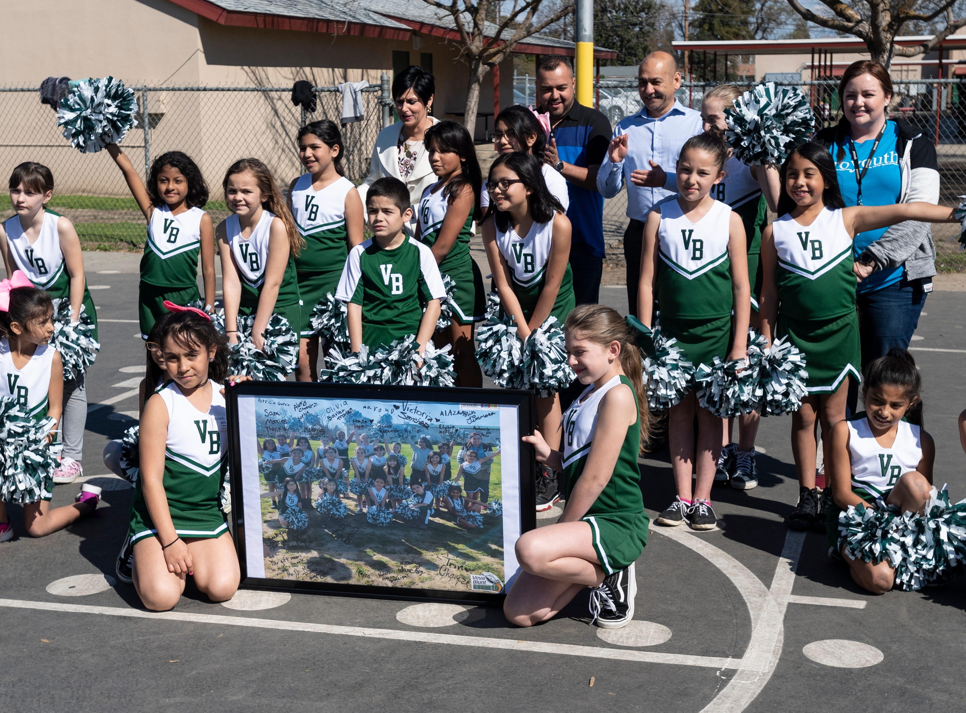 Cheerleaders show off their new uniforms during the Pro-Youth / HEART program for students at Viva Blunt School in Visalia on Wednesday, March 13, 2019. Pom-poms and 25 uniforms were donated by Julio Mendoza of NGC Construction Company.