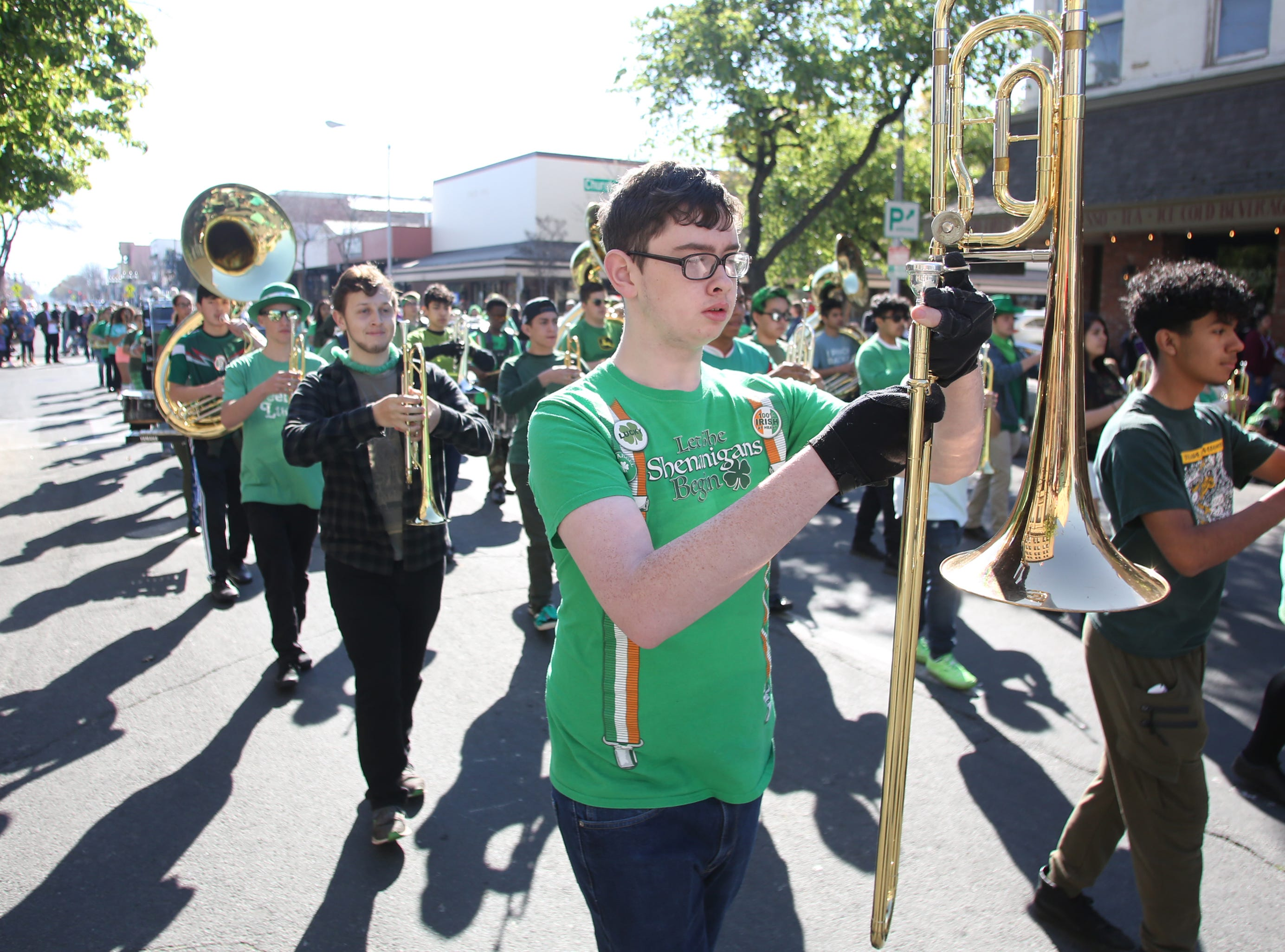 Braeden Alberstein from Golden West plays for the crowds lining the streets at this year's St. Patrick's Day parade rolling through Main Street Saturday, March 16, 2019 in Visalia, Calif.