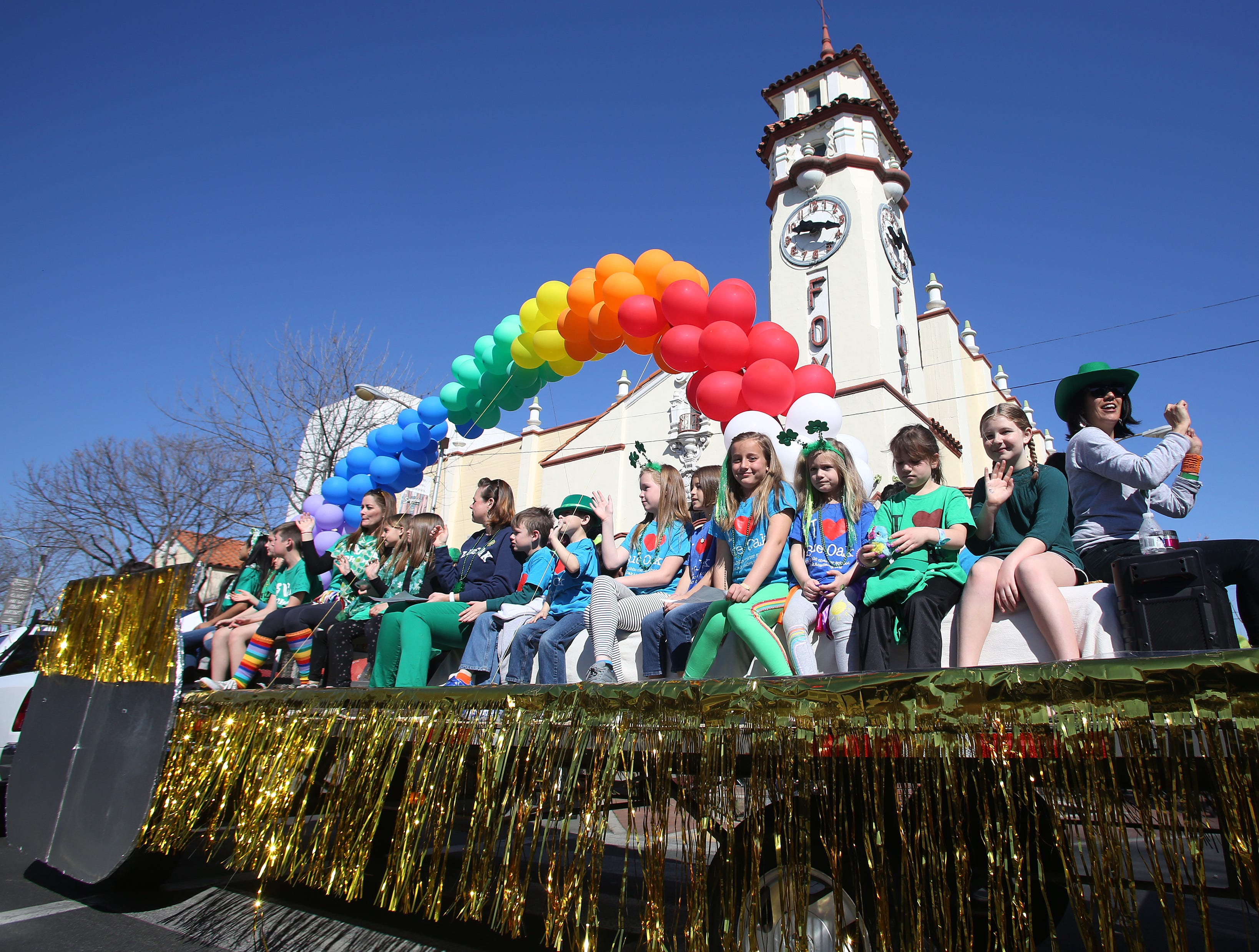 The Academies float rides on past the Fox at this year's St. Patrick's Day parade rolling through Main Street Saturday, March 16, 2019 in Visalia, Calif.