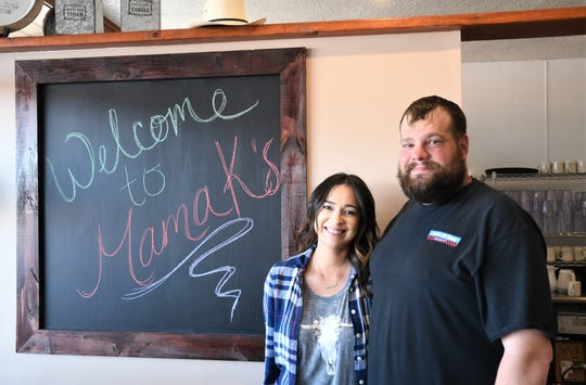 Mama K's Cafe owners Karisa Huertaz and  Michael Huff celebrate the grand reopening of their restaurant on Monday at the former Livestock Cafe.