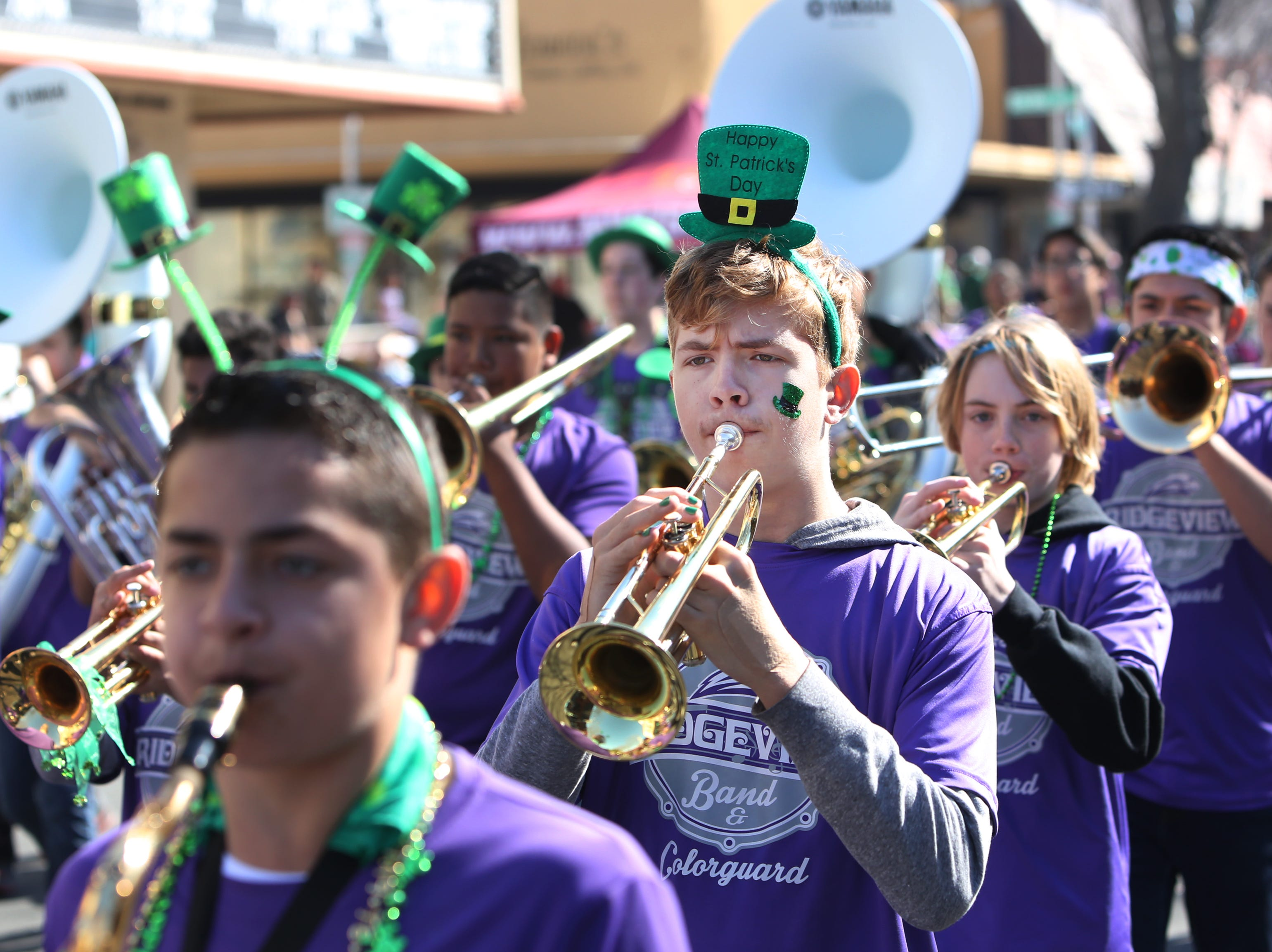 Part of the Ridgeview Band  at this year's St. Patrick's Day parade rolling through Main Street Saturday, March 16, 2019 in Visalia, Calif.