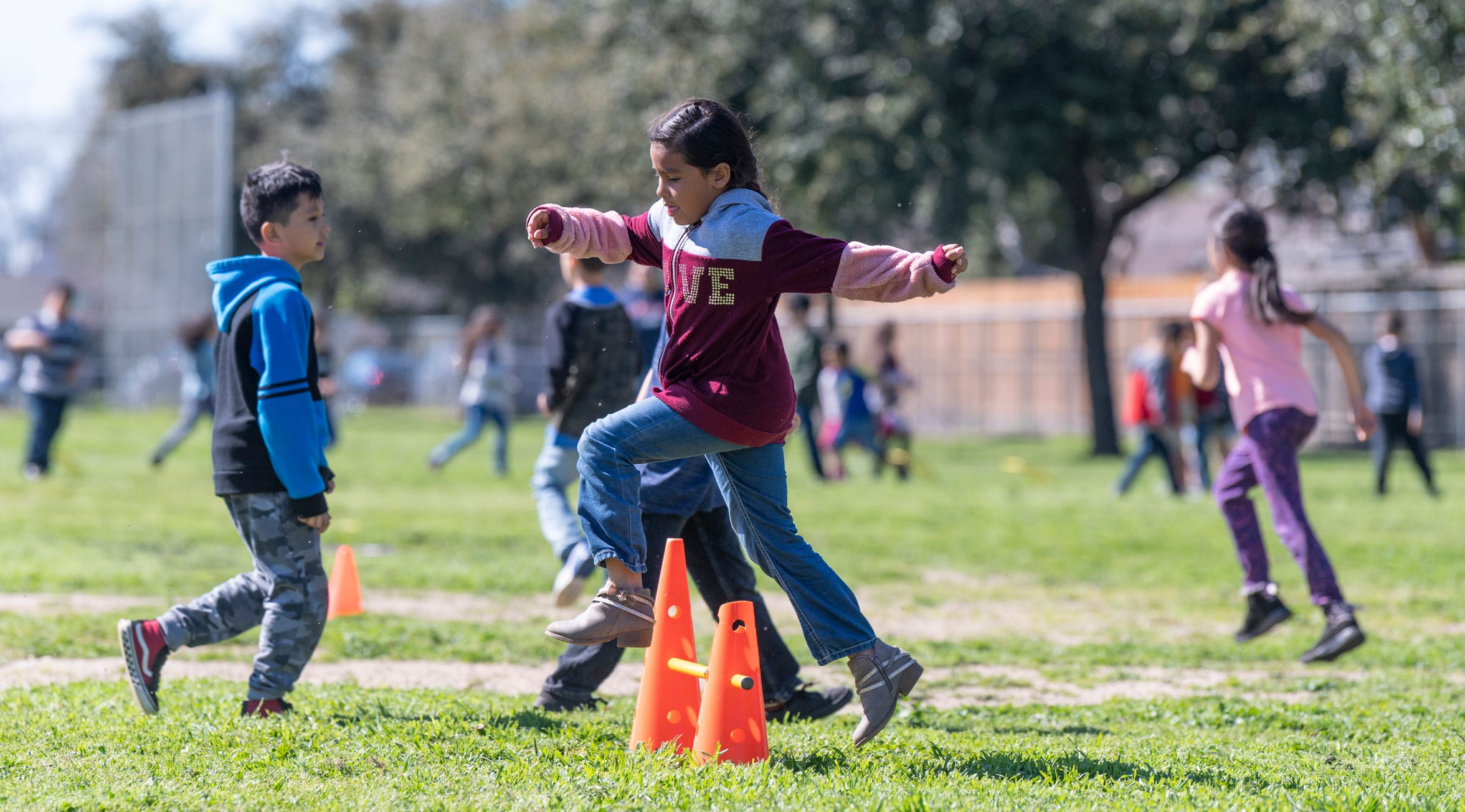 Second grader Aaliyah Manriquez jumps in the circuit exercises during Pro-Youth / HEART program for students at Viva Blunt School in Visalia on Wednesday, March 13, 2019.