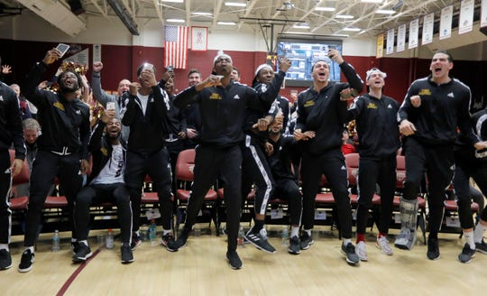 The Iona College basketball team celebrates after hearing their name called during the NCAA tournament selection show March 17, 2019. Iona, going into the tournament as a sixteen seed, will play number one seeded North Carolina on Friday in the Midwest regional in Columbus, Ohio.