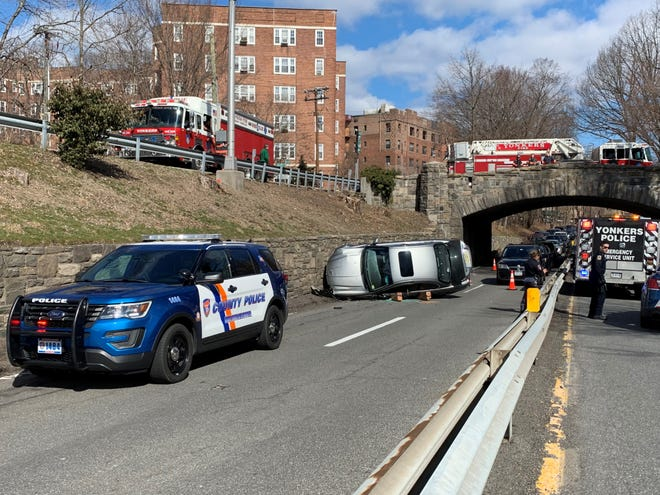 Westchester County and Yonkers Police and Yonkers Fire Department were on the scene of a rollover on the southbound Bronx River Parkway, just south of the Palmer Road overpass Sunday. When they arrived, the driver had fled. It was the third emergency-response incident within 1,000 feet of this accident site in the last week. A fire at 15 Parkview Ave., visible in this photo, just to the left of the fire truck on the overpass, displaced 150 people. And a report of a shooter at New York Presbyterian-Lawrence Hospital, about 800 feet to the right of the area in this image, brought a massive police response last Sunday.