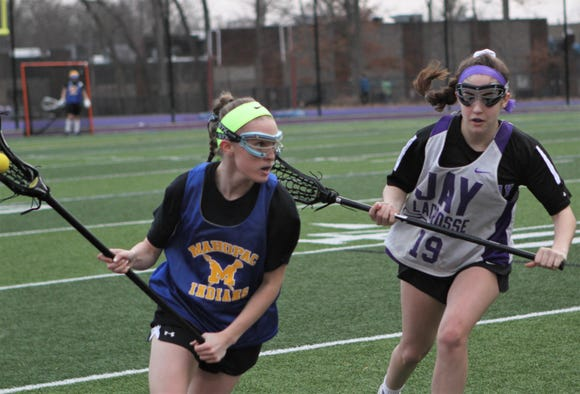 Mahopac's Caitlyn Reilly carriesthe  ball as John Jay-Cross River's Melina O'Connor defends March 15, 2019.
