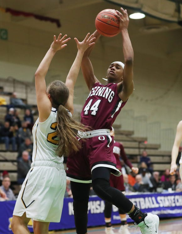 Ossining's Aubrey Griffin (44) goes up for a shot against West Genesee during the girls Class AA state championship game at Hudson Valley Community College in Troy March 17, 2019. Ossining won the game 93-46.