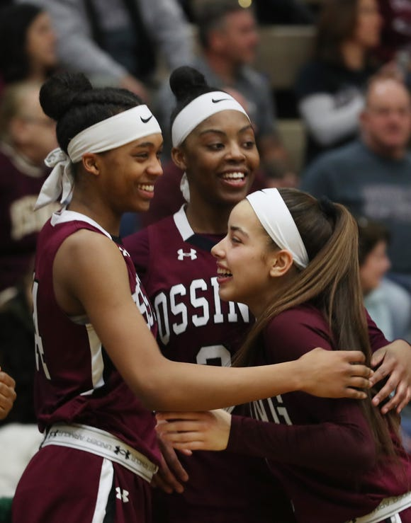 From left, Ossining's Aubrey Griffin, Kailah Harris and Jaida Strippoli  celebrate their 93-46 victory over West Genesee in the girls Class AA state championship game at Hudson Valley Community College in Troy March 17, 2019.