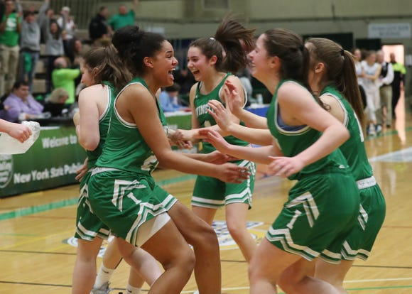 Irvington players celebrate after beating Midlakes 71-38 to win the New York State class B championship at Hudson Valley Community College in Troy March 16, 2019.