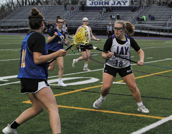 John Jay-Cross River defenseman Annie Conway (18) in action during March 15, 2019 scrimmage vs. Mahopac