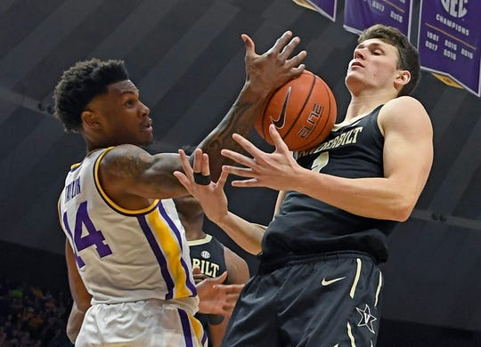 LSU guard Marlon Taylor (14) and Vanderbilt center Yanni Wetzell (1) battle for control of a rebound in the first half of an NCAA college basketball game, Saturday, March 9, 2019, in Baton Rouge, La. LSU won 80-59 thereby winning the SEC Conference outright.