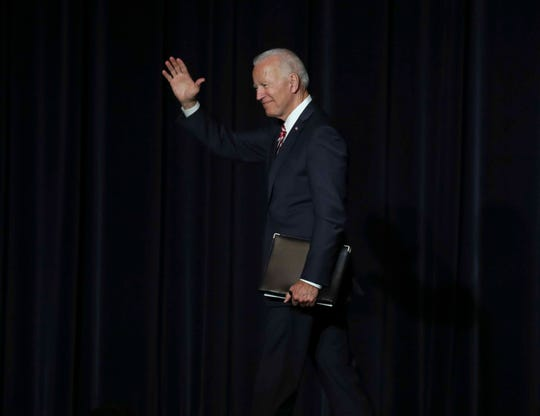 Former Vice President Joe Biden leaves the stage after delivering the keynote address during the First State Democratic Dinner statewide gathering of Delaware Democrats at Dover Downs Saturday.