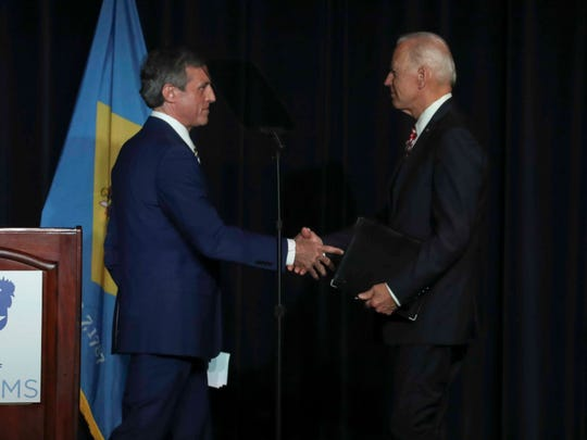 Gov. John Carney greets former Vice President Joe Biden as he takes the stage during the First State Democratic Dinner at Dover Downs March 15.