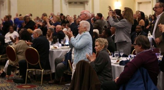 Attendees rise to applaud in the middle of the speech of former Vice President Joe Biden as he delivers the keynote address during the First State Democratic Dinner statewide gathering of Delaware democrats at Dover Downs Saturday.