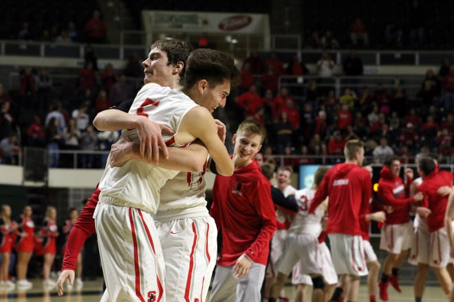 Sheridan's Costa Coconis and his teammates celebrate after beating New Philadelphia during the Division II regional finals in Athens on Saturday.