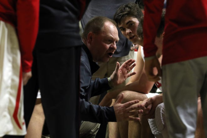 Sheridan's Doug Fisher calls a play during a timeout against New Philadelphia during the Division II regional finals in Athens on Saturday.