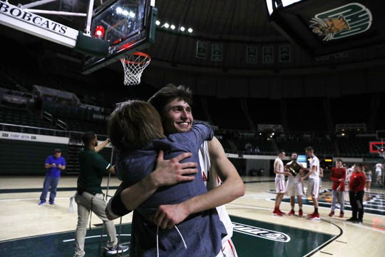 Sheridan's Costa Coconis gets a hug after the Generals beat New Philadelphia in the Division II regional finals in Athens on Saturday.