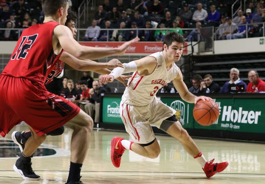 Sheridan's Ethan Heller drives with the ball against New Philadelphia during a Division II regional final in Athens. Heller was named the Times Recorder Prime Time Player of the Year.