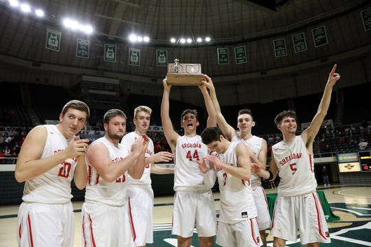 Sheridan holds up the Division II regional championship trophy.