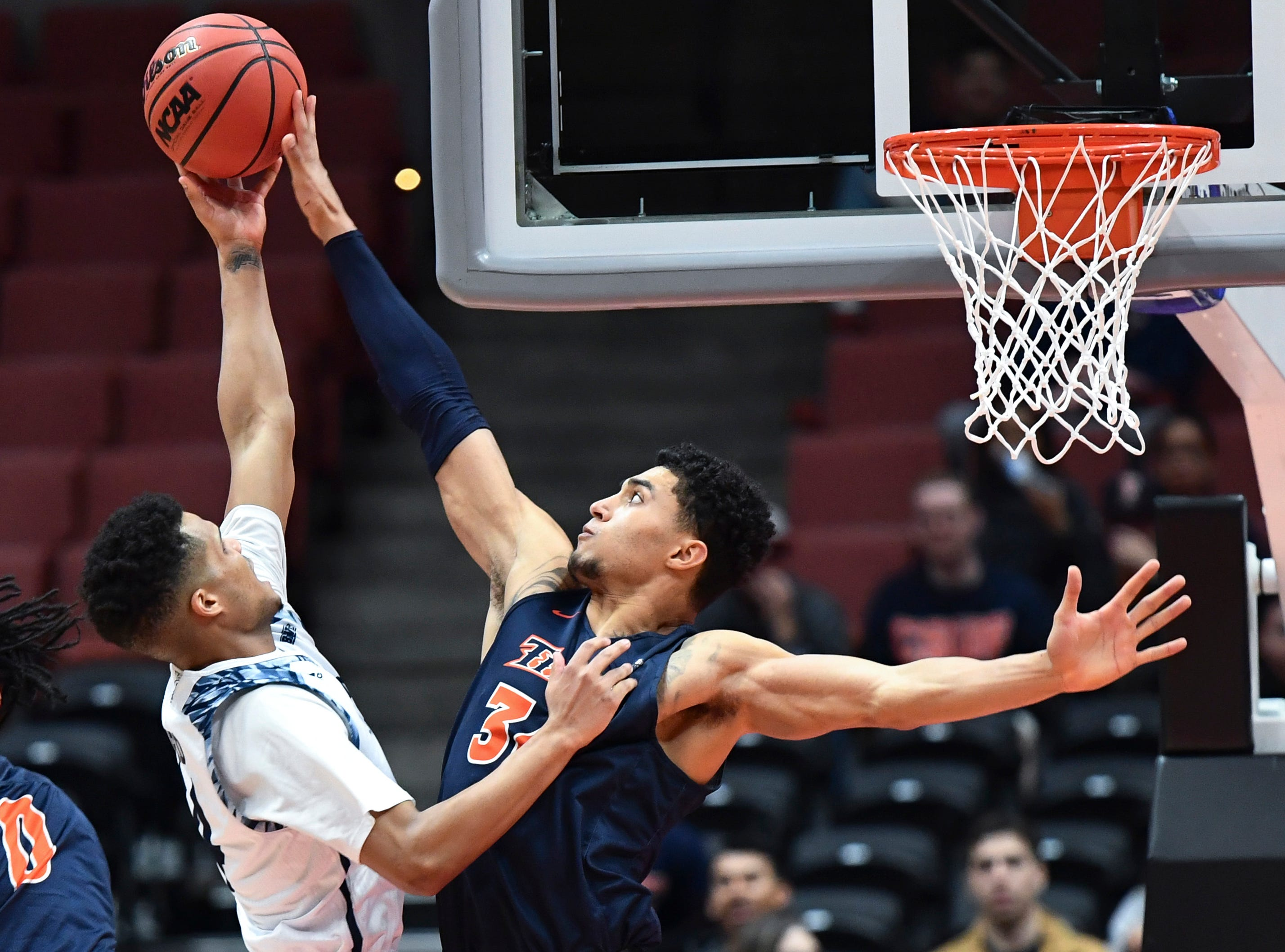 March: Cal State Fullerton Titans forward Jackson Rowe (34) blocks a shot by UC Irvine Anteaters guard Evan Leonard (14) during the first half of the Big West final.