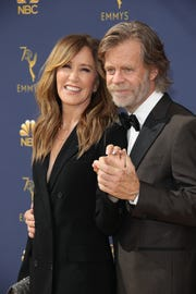 Felicity Huffman and William H. Macy arrive for the 70th Emmy Awards in Los Angeles last September.