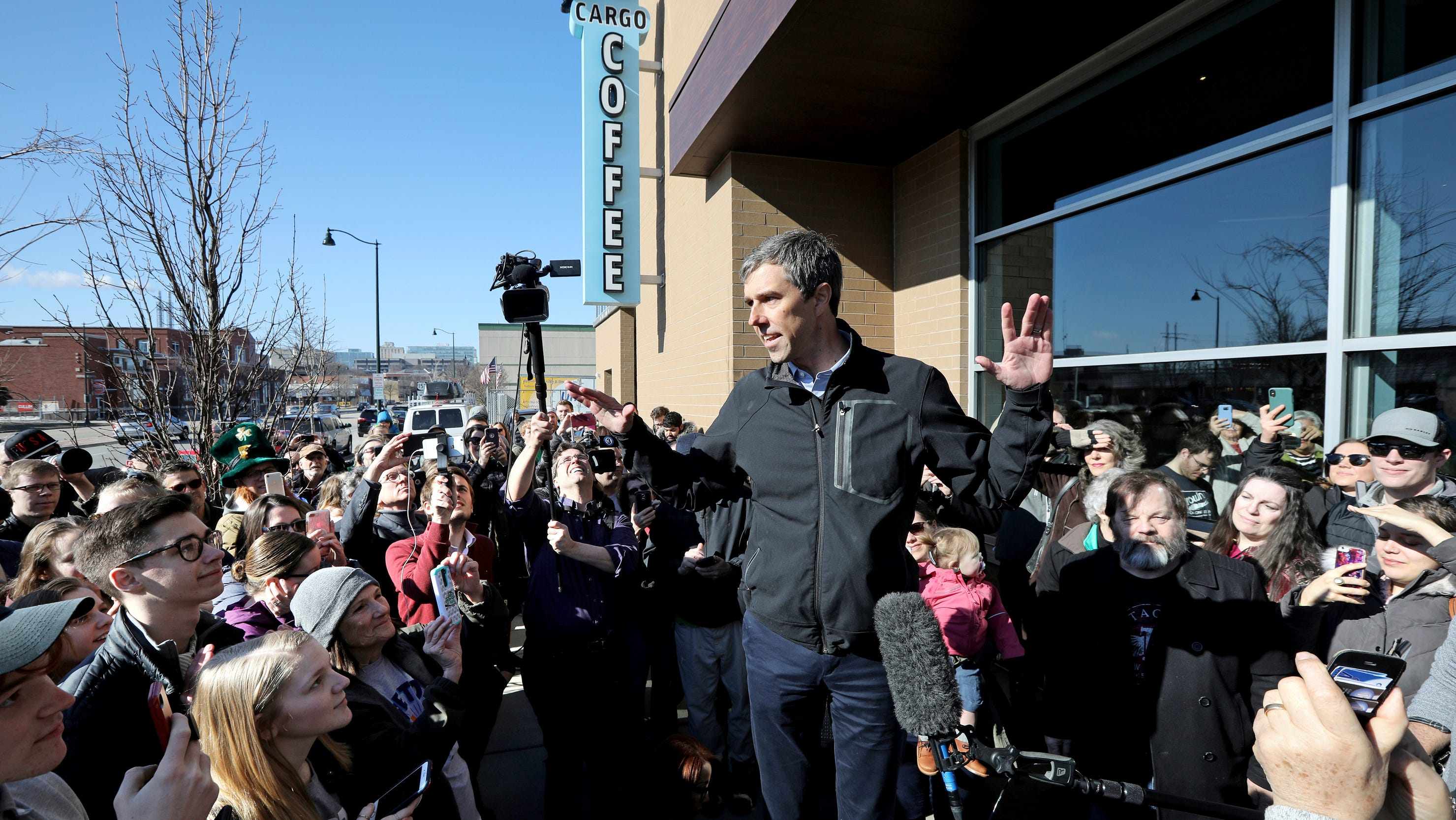 Democratic presidential candidate Beto O'Rourke talks to a crowd of people on Sunday outside Cargo Coffee in Madison, Wisconsin.