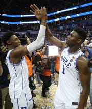 Duke Teammates RJ Barrett and Zion Williamson of the Duke Blue Devils react after defeating the Florida State Seminoles 73-63 in the championship game of the 2019 ACC Basketball Tournament.
