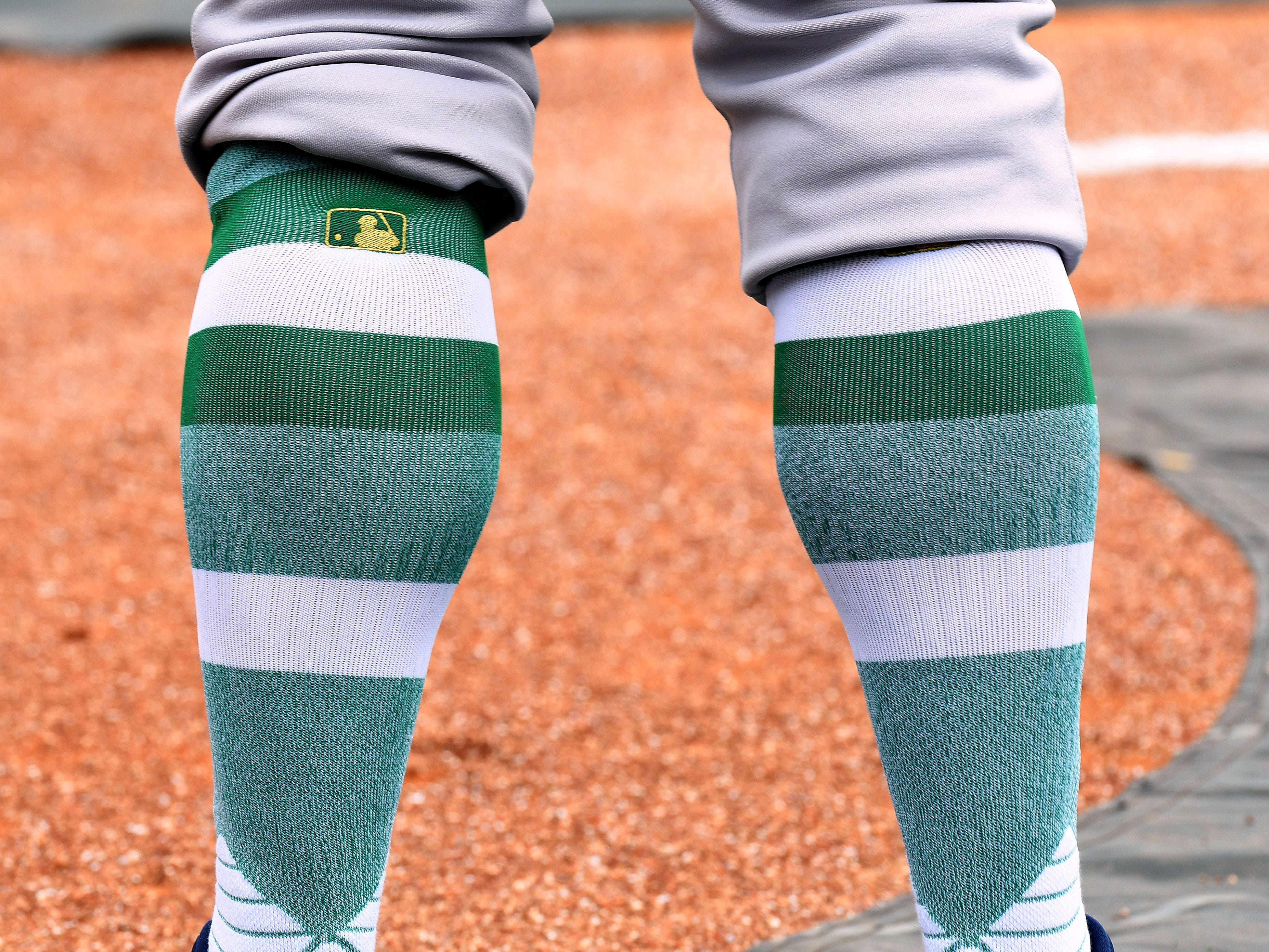 New York Yankees outfielder Matt Lipka wears St. Patrick's Day socks before the start of the spring training game against the Philadelphia Phillies at Spectrum Field in Clearwater, Fla.