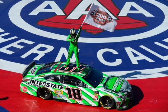 Kyle Busch celebrates after winning the  Auto Club 400.
