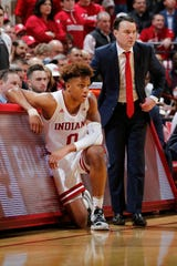 Indiana freshman guard Romeo Langford (left) and coach Archie Miller (right) were left waiting on Selection Sunday as a bubble team -- and ultimately left out of the field of 68.