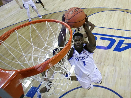 Duke's Zion Williamson goes up to dunk against Florida State during the ACC title game.