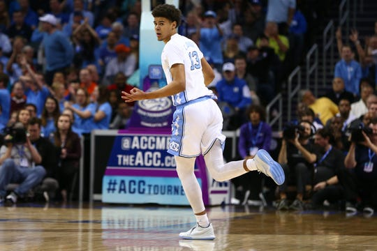 North Carolina Tar Heels guard Cameron Johnson (13) celebrates after a three point basket in the first half against the Duke Blue Devils in the ACC conference tournament at Spectrum Center.
